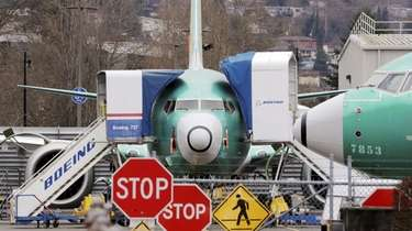 A Boeing 737 Max jet is parked in