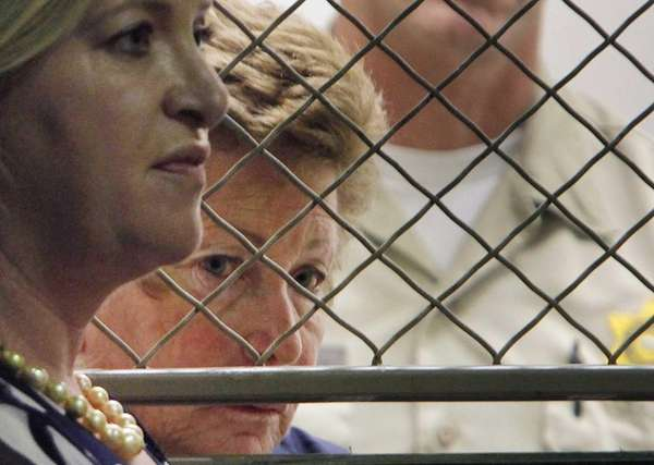Lois Goodman with her attorney, Allison Triessl, left,