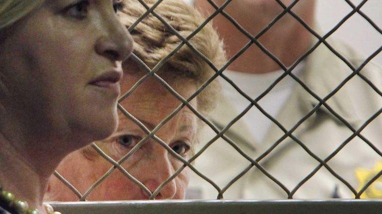 Lois Goodman with her attorney, Allison Triessl, left,