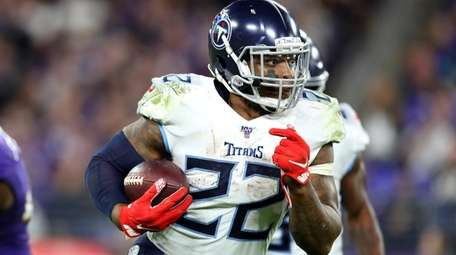 Derrick Henry #22 of the Tennessee Titans carries