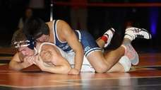Manhasset's Chris Cabrejo controls Cold Spring Harbor's RJ
