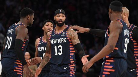 Knicks forward Marcus Morris Sr. slaps five with