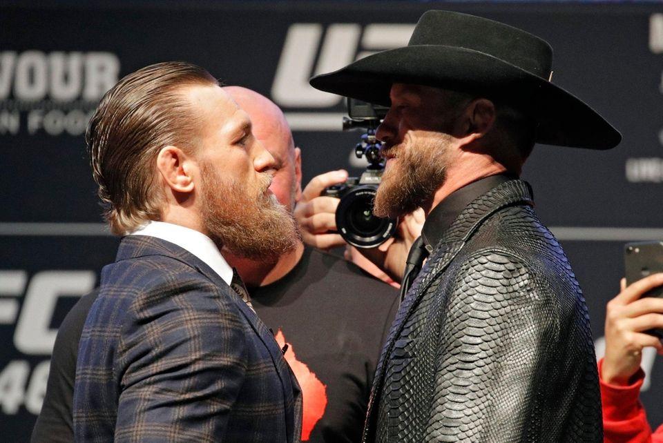 """Conor McGregor, left, and Donald """"Cowboy"""" Cerrone pose"""