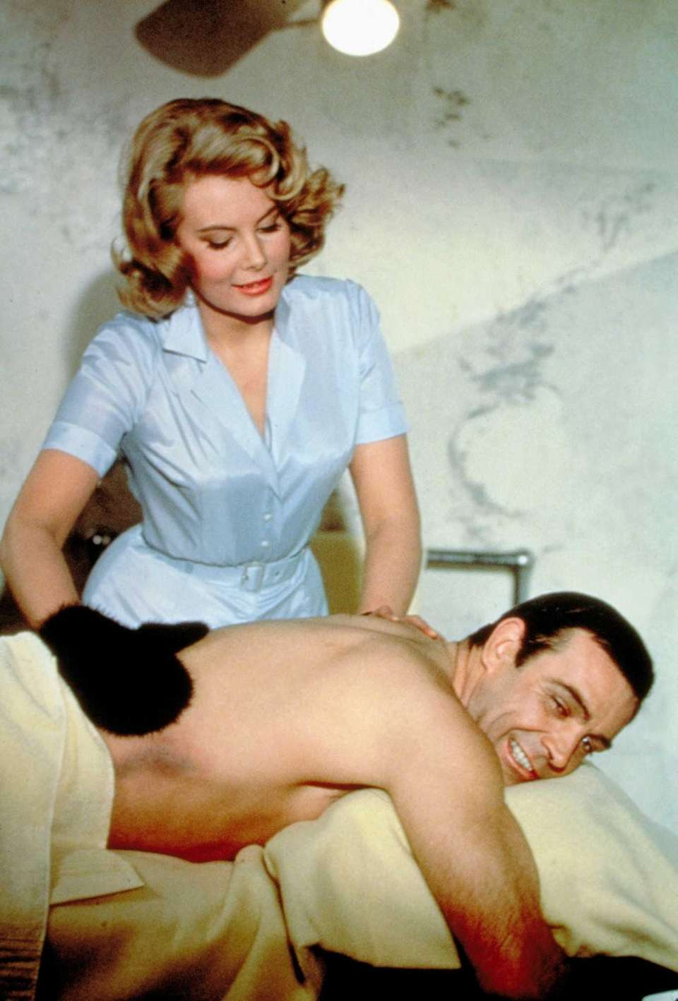 Molly Peters and Sean Connery are shown in