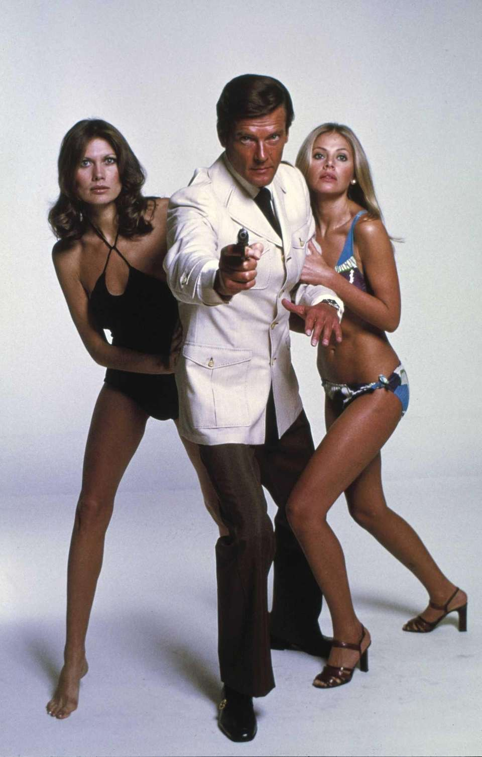 This photo shows Roger Moore, center, with Maud