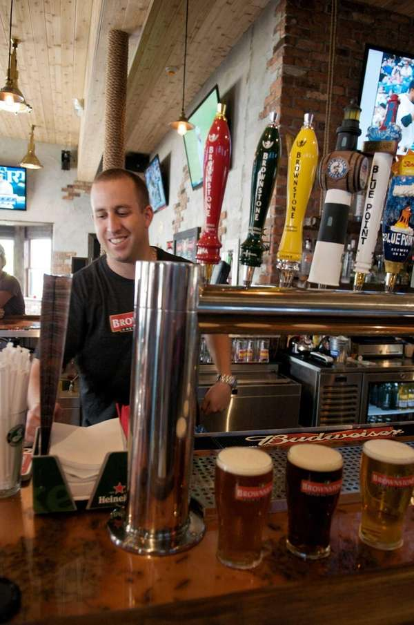 Bartender Steve Carminio behind Brownstone Brewing Company's bar,