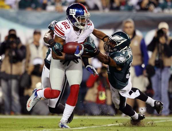 Wide receiver Rueben Randle is tackled by Philadelphia