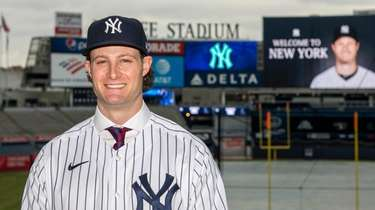 New Yankees pitcherGerrit Cole stands in Yankee Stadium