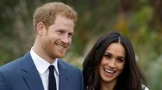 Britain's Prince Harry and Meghan Markle pose for