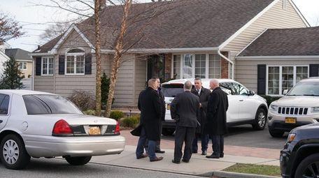 Nassau homicide detectives respond to reports of a