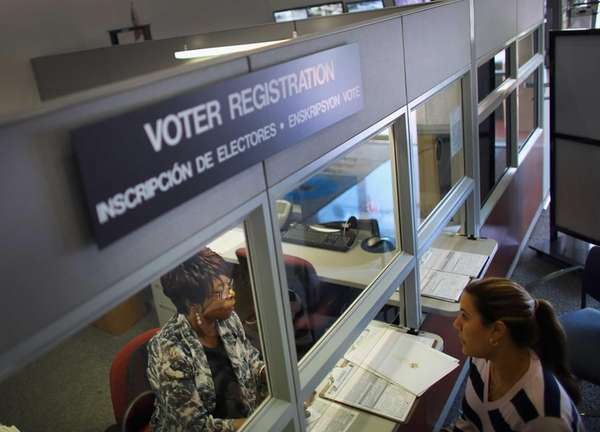 Dorothy Torrence, left, from the Miami-Dade Elections Department,