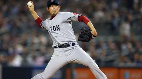 Boston Red Sox pitcher Daisuke Matsuzaka delivers a