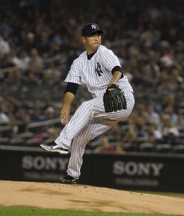 Hiroki Kuroda delivers a pitch in the top