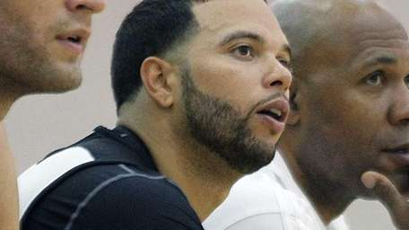 Deron Williams sits on the bench during practice