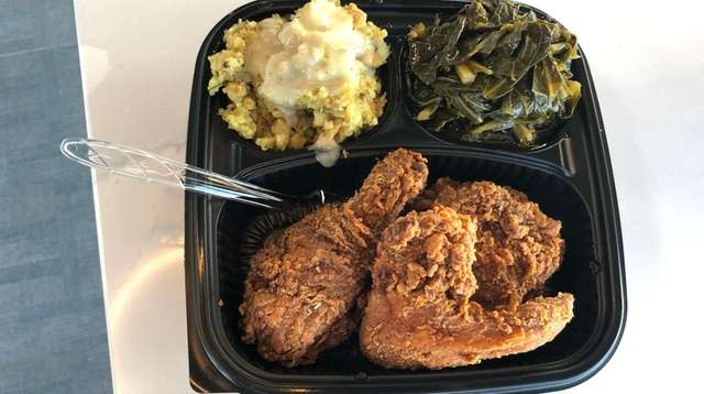 Fried chicken with collard greens and stuffing at