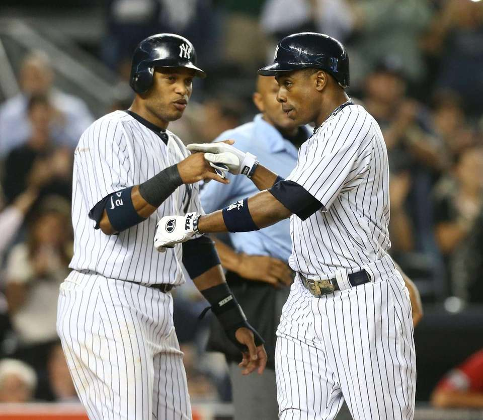 Curtis Granderson celebrates his second-inning three-run home run