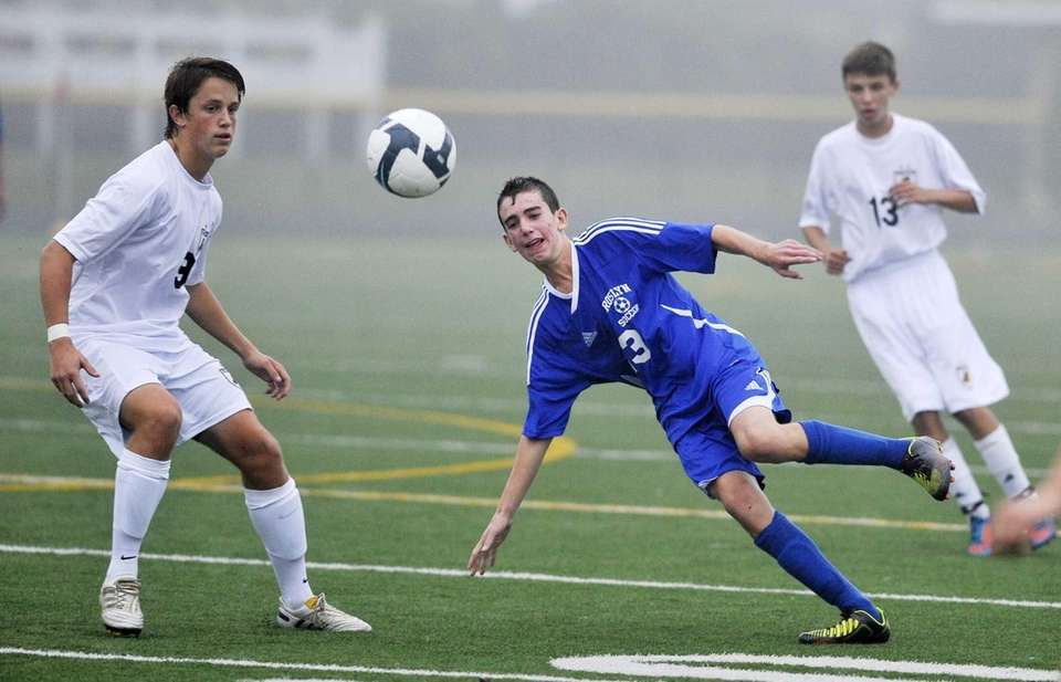 Roslyn's Nick Markman heads the ball past Wantagh's