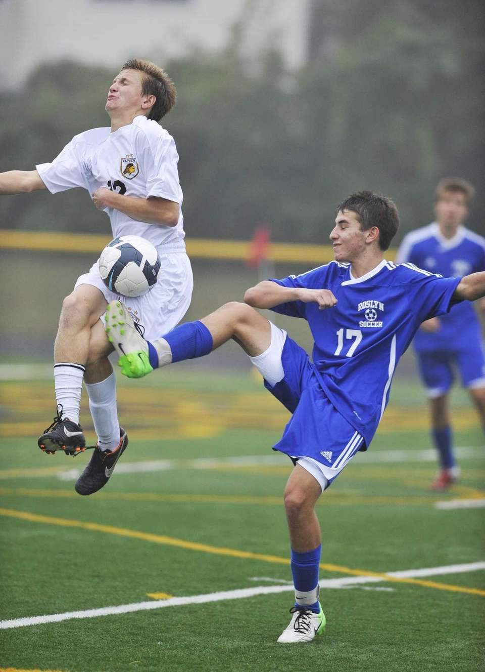 Roslyn's Kyle Galin kicks the ball past a