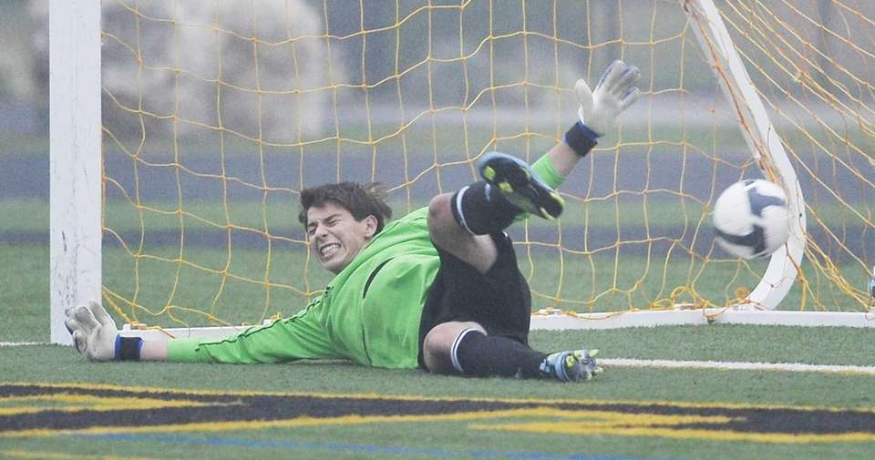 Roslyn goalkeeper Ethan Rousso fails to stop a