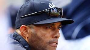 Mariano Rivera looks on from the dugout during