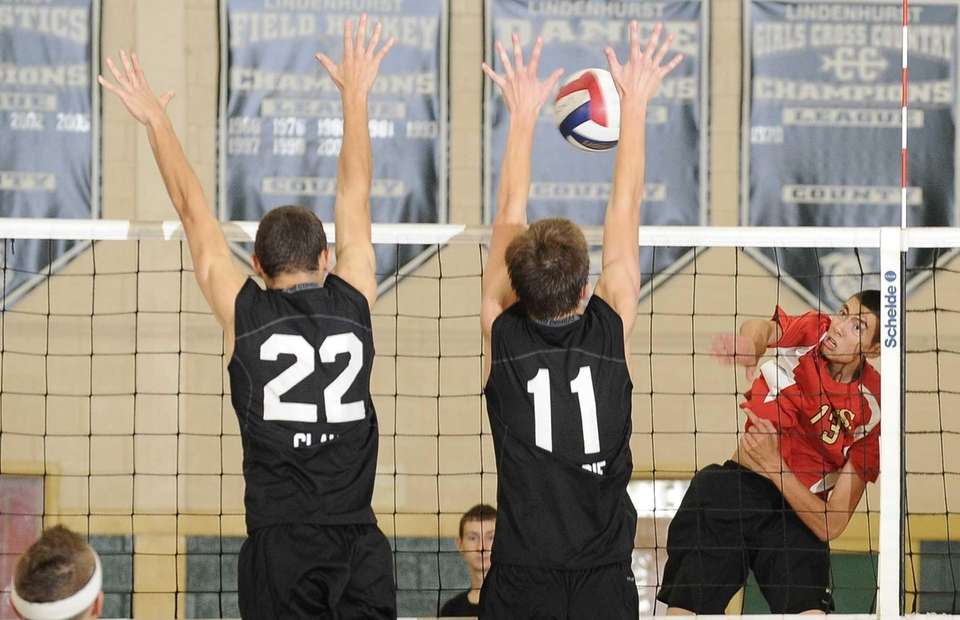 Lindenhurst's Dylan Claud and Chris DeLucie block a