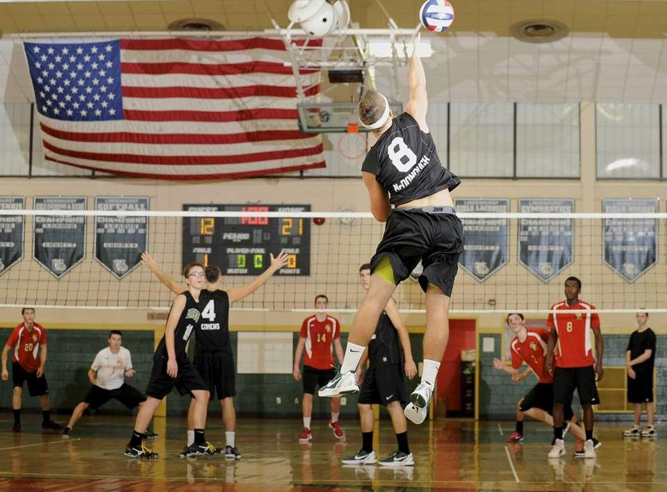 Lindenhurst's Ryan McDonough serves the ball in a