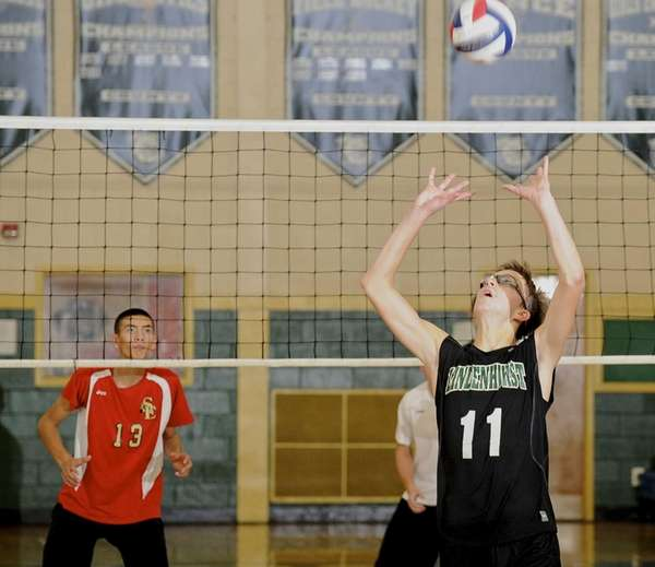 Lindenhurst's Chris DeLucie sets the ball during a