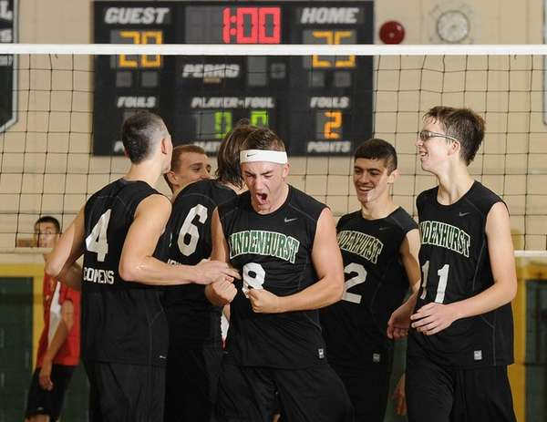Lindenhurst teammates celebrate after winning their third game