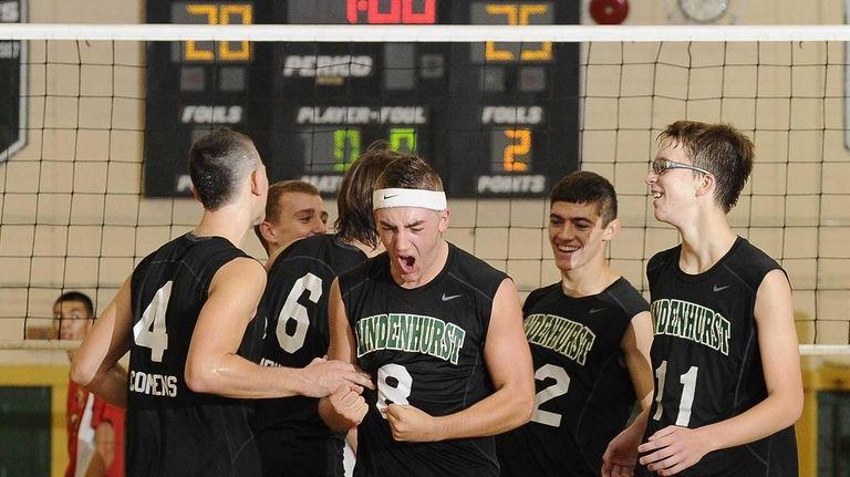 Lindenhurst teammates celebrate after winning their third game