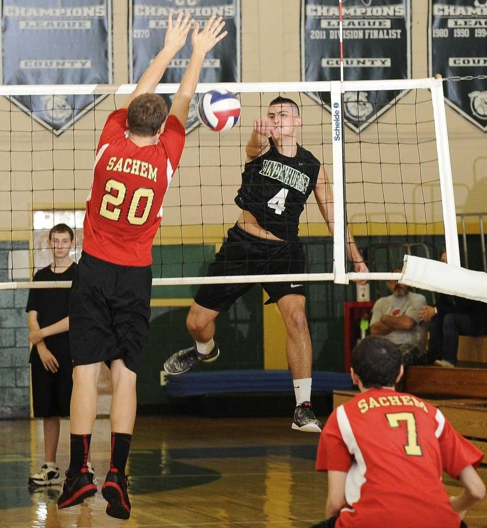 Lindenhurst's Mike Comens hits a shot past Sachem