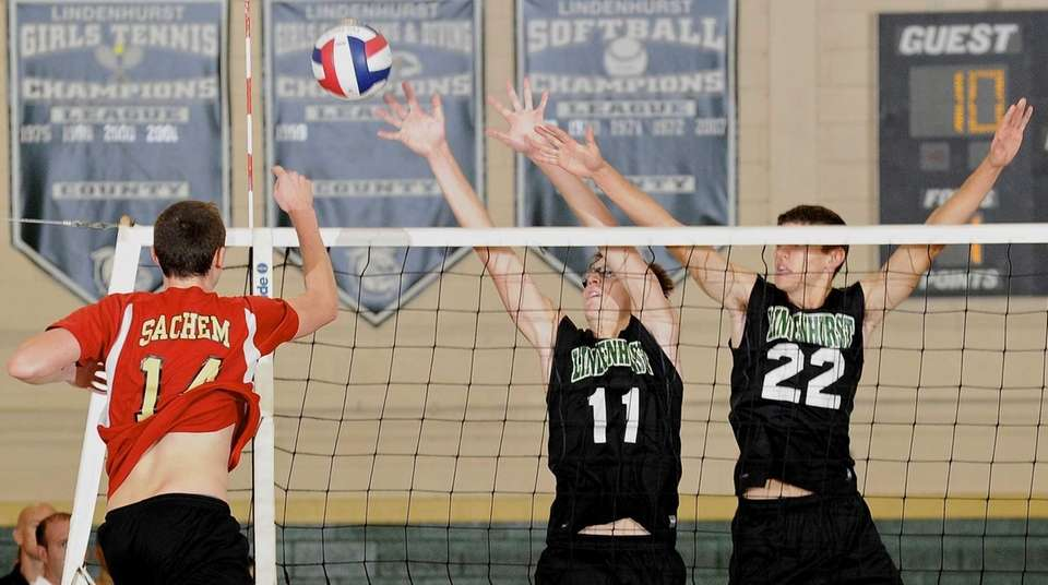 Lindenhurst's Chris DeLucie, center, and Dylan Claud, right,