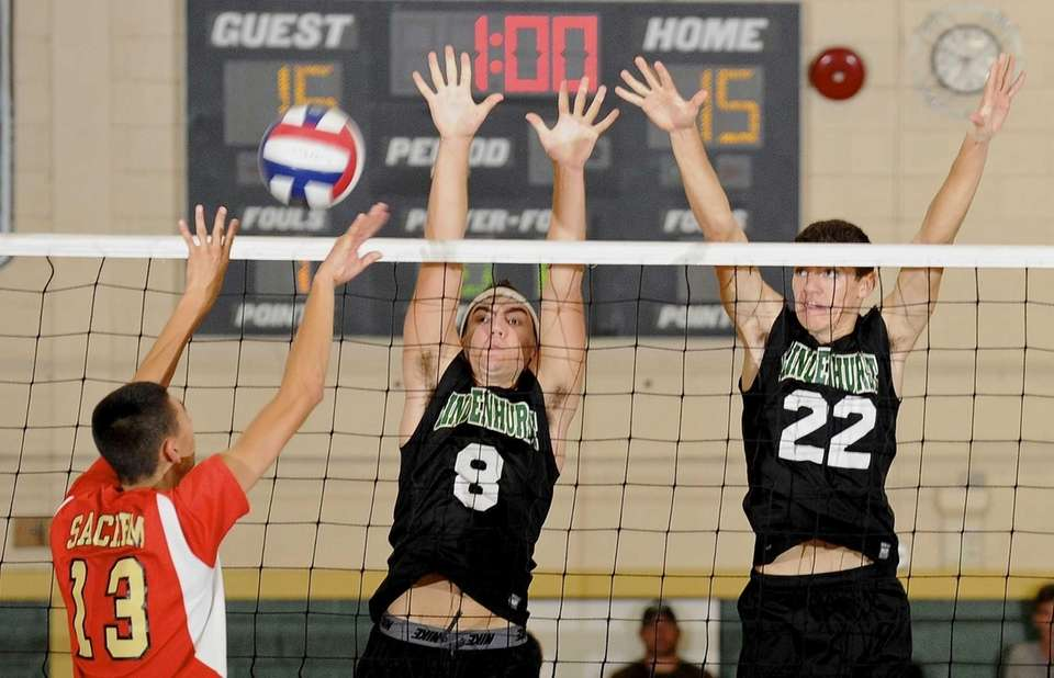 Lindenhurst's Ryan McDonough and Dylan Claud block a