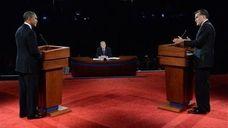 President Barack Obama listens as Republican presidential nominee