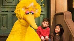 Big Bird reads to Connor Scott and Tiffany