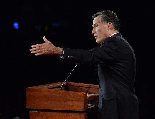Republican presidential nominee Mitt Romney answers a question