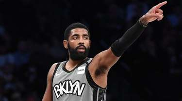 Nets guard Kyrie Irving gestures during the first
