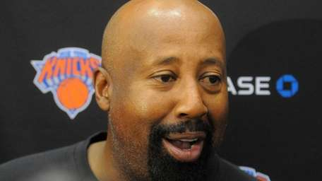 Knicks head coach Mike Woodson speaks to the