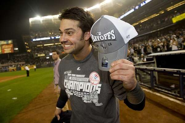 Nick Swisher smiles for a photographers after the