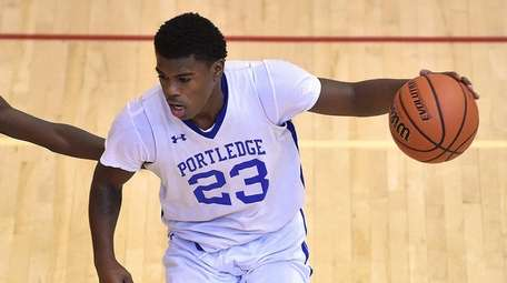 Zaire Baines #23 of Portledge, right, gets pressured
