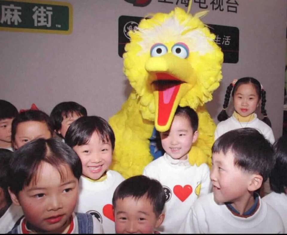 "Shanghai children surround ""Sesame Street's"" Big Bird. The"