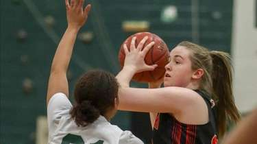 Sachem East's Ashley Pavan #32 looks to pass