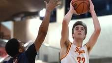 Kieran Dorney #32 of Chaminade, right, takes a