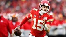 Kansas City Chiefs quarterback Patrick Mahomes runs the