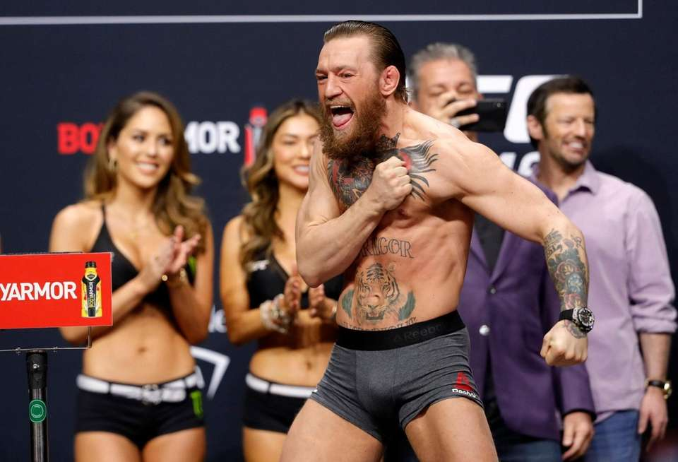Welterweight fighter Conor McGregor calls out during a
