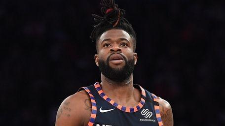 Knicks guard Reggie Bullock looks on against the