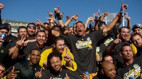 Oakland Athletics players celebrate on the pitcher's mound