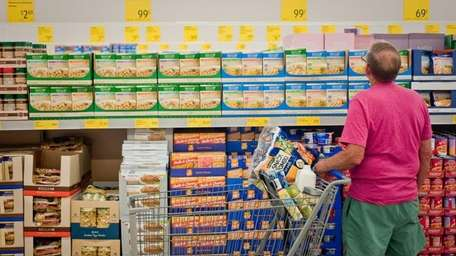 A shopper browses at ALDI, a discount grocery