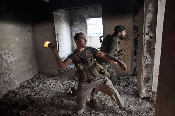 Free Syrian Army soldier throws a petrol bomb