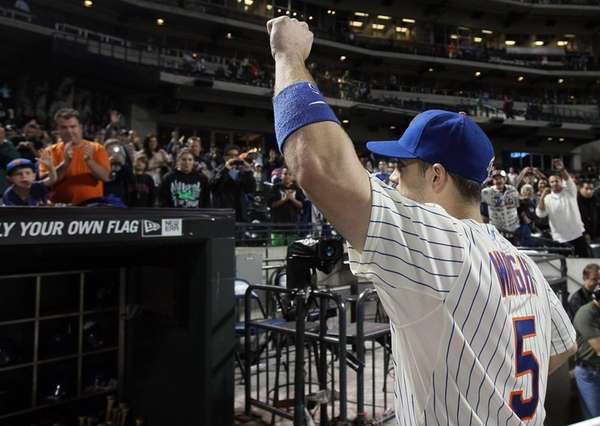 David Wright waves to fans after a game