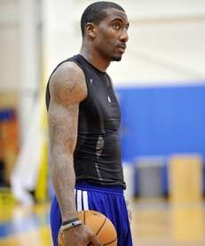 Amar'e Stoudemire stands with the ball during practice.